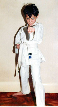 Child in karate stance and outfit